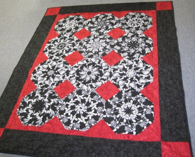 red, black, and white Stack and Whack quilt